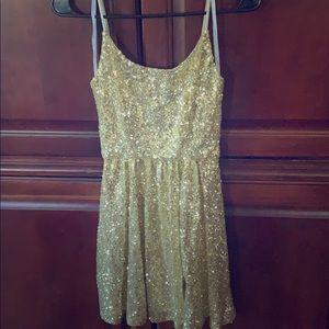 Gold sparkly formal dress.